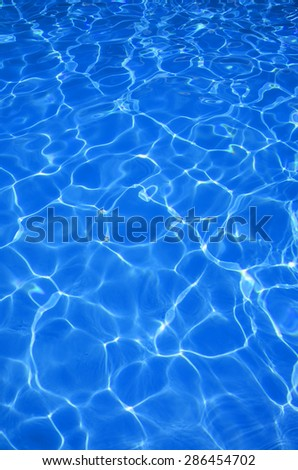 beautiful clear pool water reflecting in the sun background