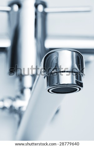 beautiful close-up faucet in the modern bathroom - stock photo