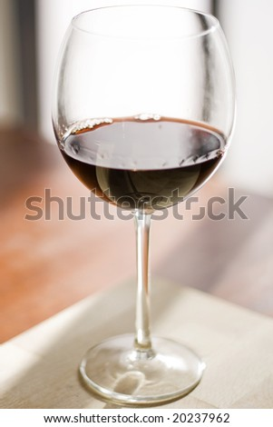 beautiful close up portrait of a red wine cup. - stock photo