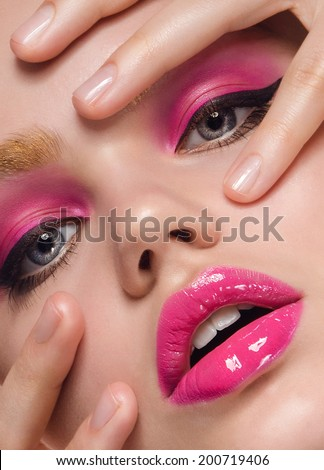 beautiful close-up portrait of a young girl with caramel  lips in pink color, with large blue eyes, shining pearly skin on white background