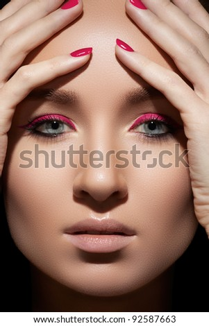 Beautiful close-up portrait of fashion woman model with glamour magenta makeup, pale lips, bright pink nail polish. Fresh style, visage and manicure - stock photo