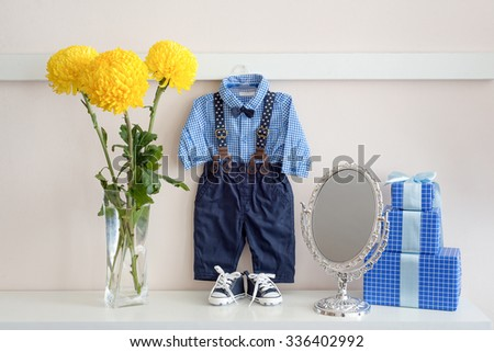 Beautiful clothes for newborn boy. Celebration. Pregnancy and birth expectation.