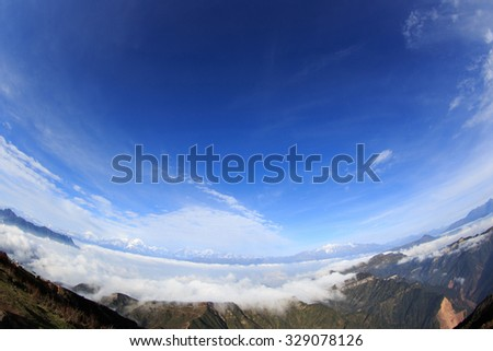beautiful clouds and fog among mountain summits landscape - stock photo