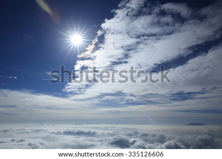 beautiful clouds and fog among mountain summits sunset landscape - stock photo