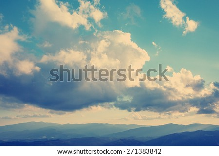Beautiful clouds at sunset in the mountains.Vintage filter instagram. - stock photo