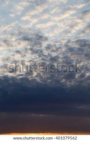 beautiful clouds dawn sun as background - stock photo