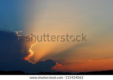 beautiful clouds storm at sunset - stock photo