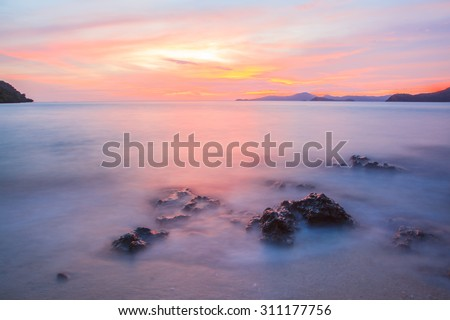 Beautiful cloudy abstract background,Golden sunset and mist sea Thailand. - stock photo