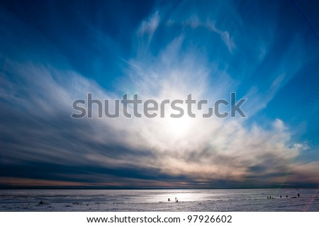 Beautiful cloudy and blue sky over ice lake in Saint-Petersburg, Russia - stock photo