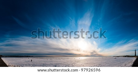 Beautiful cloudy and blue sky panorama over ice lake in Saint-Petersburg, Russia - stock photo