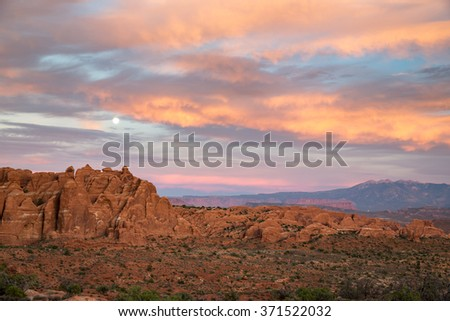 Beautiful cloudy sunset over Arches National Park in Utah, USA. - stock photo