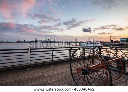 Beautiful cloudy sunset viewed at Lonsdale Quay, North Vancouver, British Columbia, Canada. - stock photo