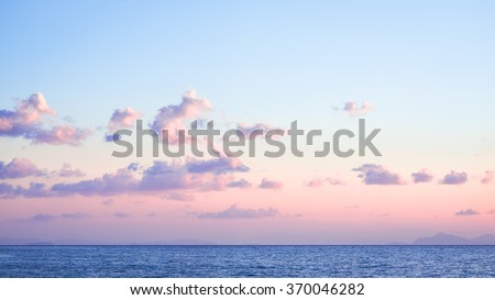 Beautiful coastal landscape pink sunrise on the endless ocean with the colors of the year 2016 rose quartz and serenity - stock photo
