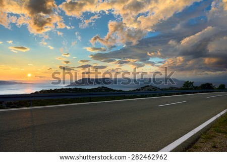 Beautiful coastal road at sunset in croatia - stock photo