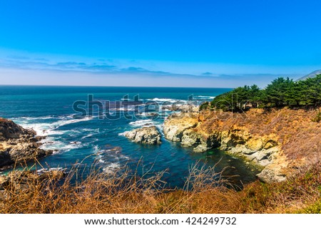 Beautiful coastline scenery on Pacific Coast Highway #1 at the US West Coast traveling south to Los Angeles, Big Sur Area, California - stock photo