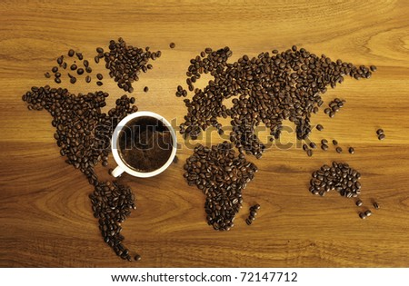 Beautiful coffee map on wooden background. International coffee industry concept - stock photo