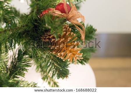 Beautiful color Christmas pine cone on green branches - stock photo