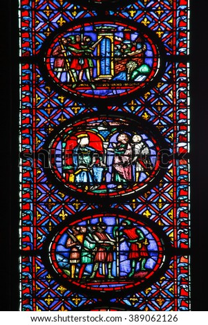 Beautiful colored ancient stained glass depicting a medieval scene  - stock photo
