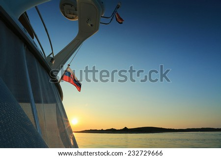 Beautiful colored sunset from yacht in the sea, Croatia - stock photo