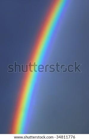 Beautiful, colorful, bright rainbow - stock photo