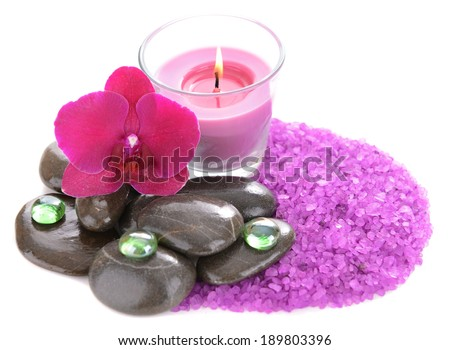 Beautiful colorful candles and orchid flower, isolated on white - stock photo