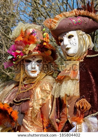 Beautiful colorful couple at the 2014 venetian carnival of Annecy, France