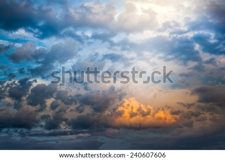 Beautiful colorful dramatic blue and orange clouds skyscape with fluffy clouds illustration of the gate of heaven  - stock photo
