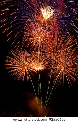 Beautiful colorful fireworks with night sky - stock photo