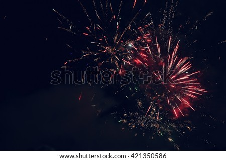 Beautiful colorful holiday fireworks in the night sky. - stock photo