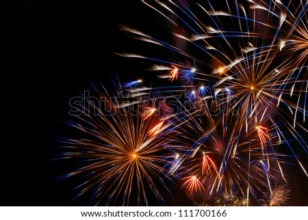 Beautiful colorful holiday fireworks on the black sky background, close-up, long exposure - stock photo
