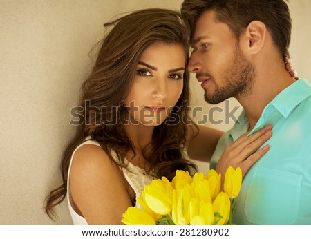 Beautiful colorful portrait of young couple - stock photo