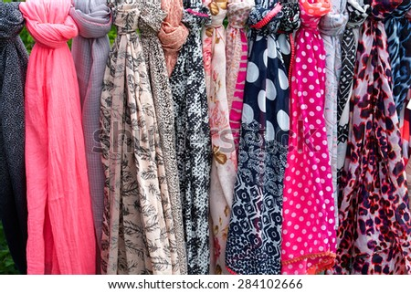 Beautiful colorful scarves hanging  in a fashion accessories shop                                - stock photo