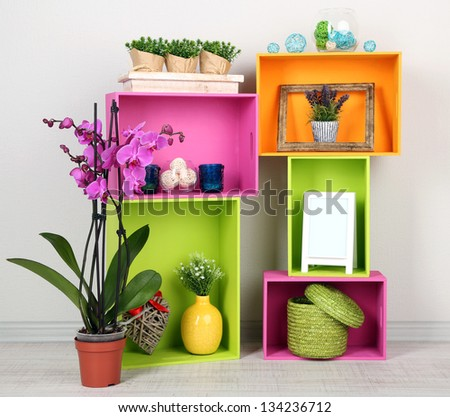 Beautiful colorful shelves with different home related objects - stock photo