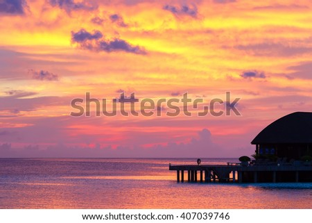 Beautiful colorful sky on sunset at tropical island in Indian Ocean - stock photo