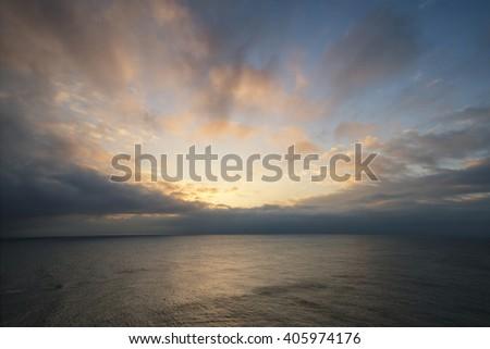Beautiful colorful sunrise landscape over calm sea  - stock photo