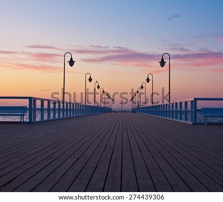 Beautiful colorful Sunrise on the pier at the seaside, Gdynia Orlowo, Poland. Long exposure photography. HDR photo.  - stock photo