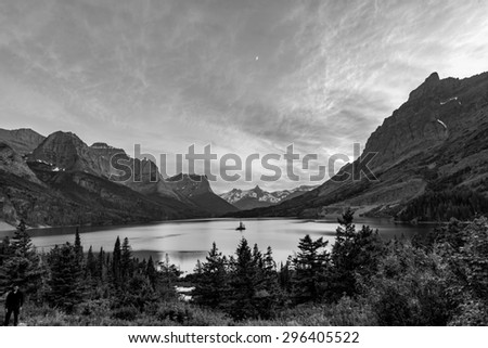 Beautiful colorful sunset over St. Mary Lake and wild goose island in Glacier national park. - stock photo