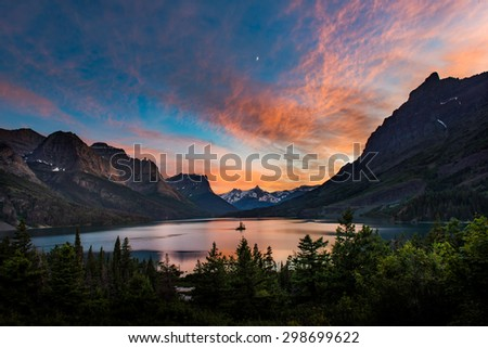 Beautiful colorful sunset over St. Mary Lake and wild goose island in Glacier national park - stock photo