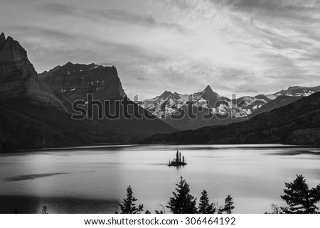 Beautiful colorful sunset over St. Mary Lake and wild goose island in Glacier national park Black and White - stock photo