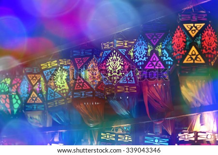 Beautiful colorful traditional lanterns through colorful lights lit on the occasion of Diwali / Christmas festival in India - stock photo