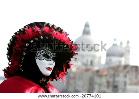 Beautiful colours of costumes during Venice carnival - stock photo