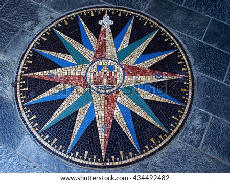 Beautiful compass directions wind rose made from colorful mosaic stones - stock photo
