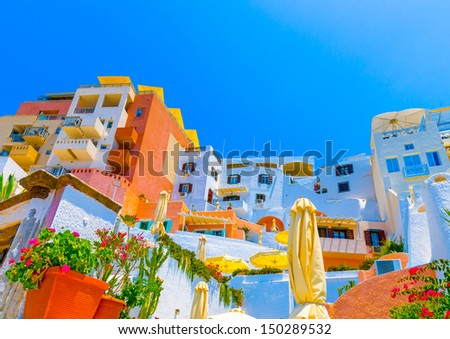 Beautiful complex of colored houses in Fira the capital of Santorini island in Greece - stock photo