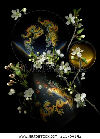 Beautiful composition made from branchlet of cherries and Chinese painting handmade - stock photo