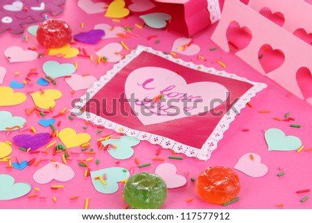 Beautiful composition of paper valentines and decorations on pink background close-up - stock photo