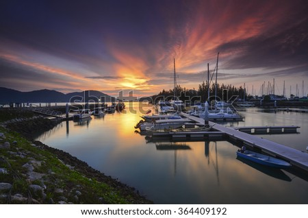 Beautiful composition view of Malaysian Harbour with a yatch during sunset - stock photo