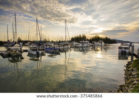 Beautiful composition view of Malaysian Harbour with a yatch during sunset.Vibrance colour - stock photo