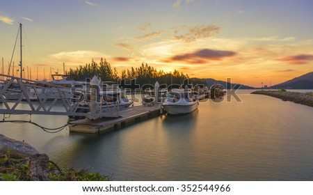 Beautiful composition view of Malaysian Harbour with a yatch during sunset.Vibrance colour. Copy Space Area - stock photo