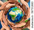 Beautiful conceptual symbol of the Earth globe with multiracial human hands around it. Unity and world peace concept. - stock