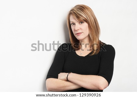 Beautiful confident woman with serious expression - stock photo